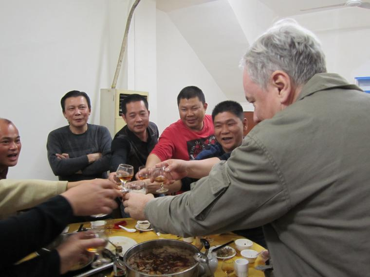 Peter drinking Chinese rice spirit against his will Guangdong 2011